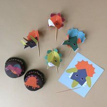 Load image into Gallery viewer, dinosaur-cupcake-decoration-with-cupcake-liners-and-dinoasur-heads-on-toothpicks