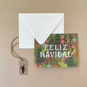 fir-tree-and-floral-background-greeting-card-with-the-text-feliz-navidad-in-white-lettering