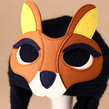 Load image into Gallery viewer, knitted-navy-hat-with-chin-strap-and-brown-kangaroo-removable-felt-mask-with-yellow-ears