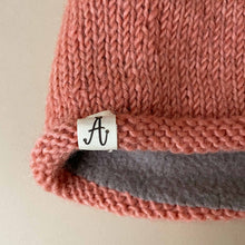 Load image into Gallery viewer, close-up-of-hand-knit-hunter-hat-label