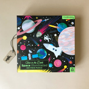 glow-in-the-dark-illuminated-space0puzzle-with-planets-astronauts-rocket-and-sattelite-on-starry-background