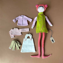 Load image into Gallery viewer, bertille-doll-in-lime-green-dress-with-coral-hat-and-leggins-and-second-outfit-of-pink-sweater-striped-shirt-and-green-striped-leggings