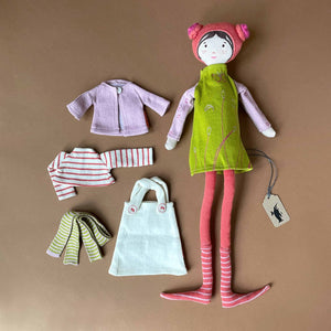 bertille-doll-in-lime-green-dress-with-coral-hat-and-leggins-and-second-outfit-of-pink-sweater-striped-shirt-and-green-striped-leggings