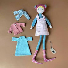Load image into Gallery viewer, colette-doll-in-pink-dress-with-blue-undershirt-and-bright-pink-hat-and-a-second-outfit-of-blue-dress-pink-sweater-and-striped-leggings