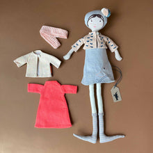 Load image into Gallery viewer, dorothee-doll-in-pink-sweater-grey-hat-and-dress-with-second-outfit-of-bright-pink-dress-oatmeal-sweater-and-striped-leggings