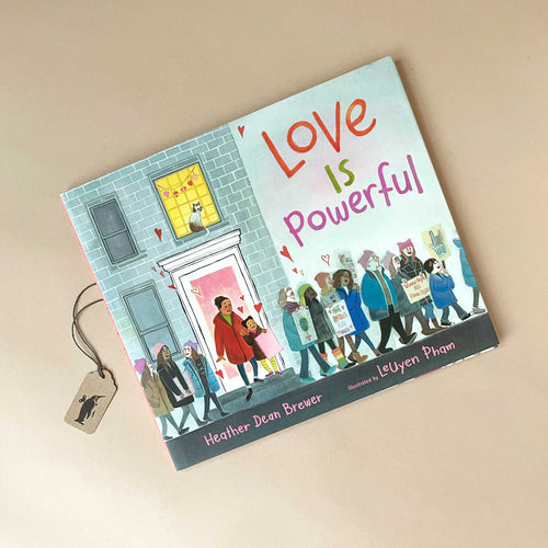 love-is-powerful-by-heather-dean-brewer-book-cover-featuring-a-diverse-group-of-people-walking-in-a-protest-along-the-street