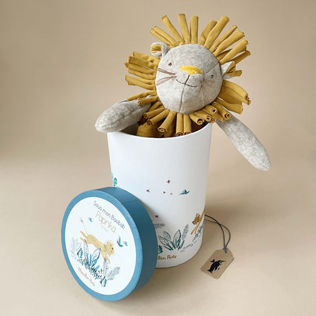 paprika-the-lion-stuffed-animal-with-mustard-accents-in-cylindrical-gift-box