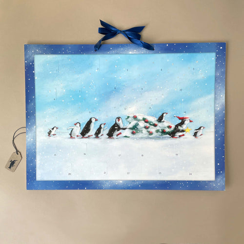 penguins-story-advent-calendar-in-blue-frame-illustrated-with-penguins-carrying-christmas-tree-across-the-snow