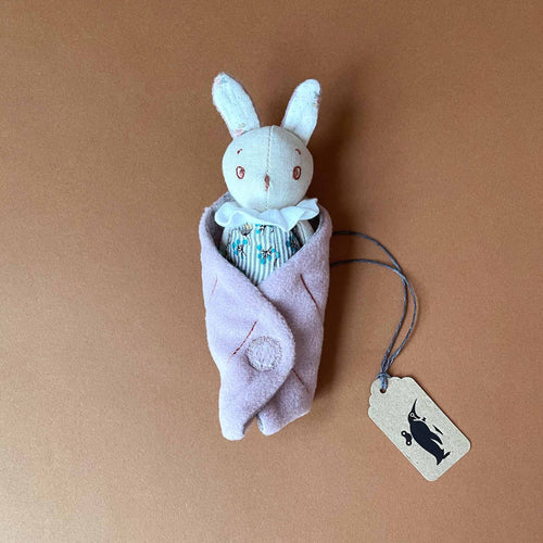 petite-mousse-rabbit-in-blue-striped-dress-in-pink-leaf-blanket