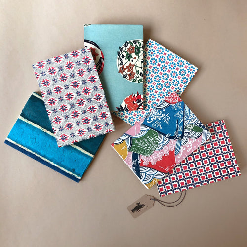 six-petite-hand-bound-notebooks-in-blue-multi-tones-in-floral-lichen-floral-globes-blue-daisies-mountains-batik-stipes-and-tiled