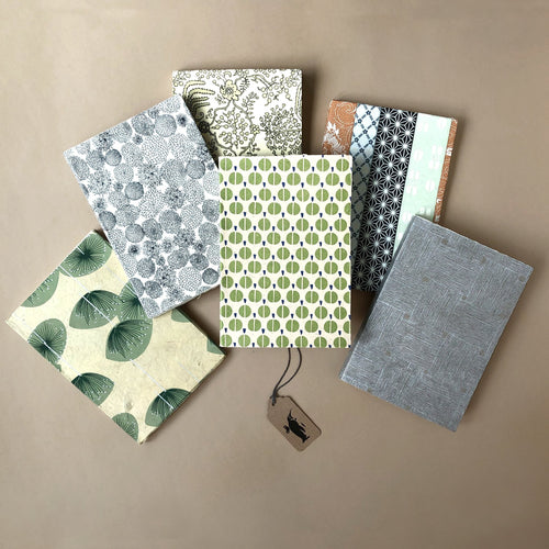 six-petite-hand-bound-notebooks-in-neutral-tones-chrysanthemum-rose-garden-green-trees-lotus-silver-weave-and-kimono