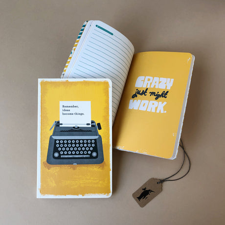 Front-cover-and-inside-page-of-Remember-Ideas-Become-Things-softback-journal-yellow-background-with-grey-typewriter