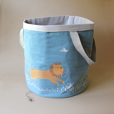 round-storage-bin-lion-with-blue-exterior-and-gray-interior-fabric-with-running-lions-by-moulin-roty