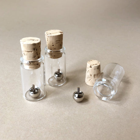 upside-down-metal-tops-in-glass-jars-with-cork-stoppers