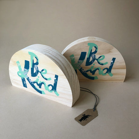 wood-block-art-be-kind-semi-circle-block-with-blue-and-aqua-text
