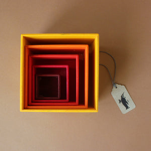 wooden-nesting-boxes-in-warm-colors-nested