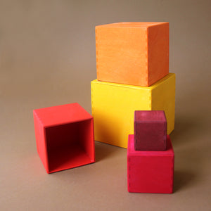 wooden-nesting-boxes-in-warm-colors-stacked