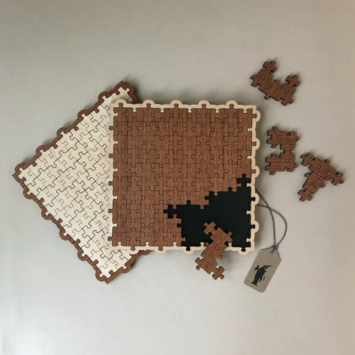 wooden-pento-puzzle-with-glued-togthe-jigsaw-pieces