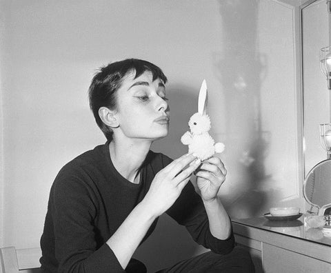 Audrey Hepburn with lucky rabbit figurine charm
