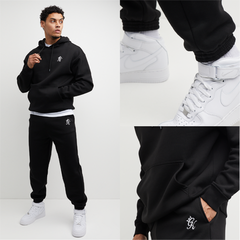 Mens Oversized Tracksuit in black. Hoodie and Joggers are made from premium fabric, cuff rib and drawstrings