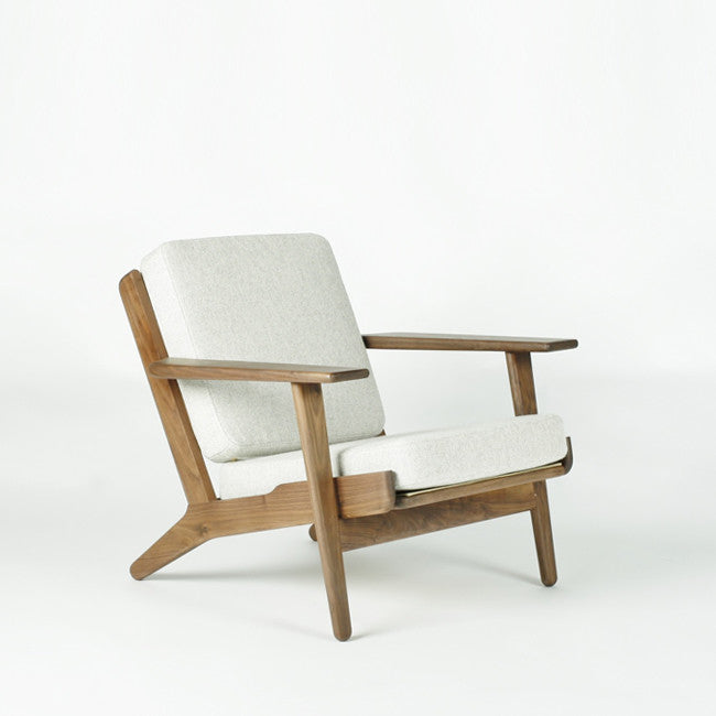 white wooden lounge chair