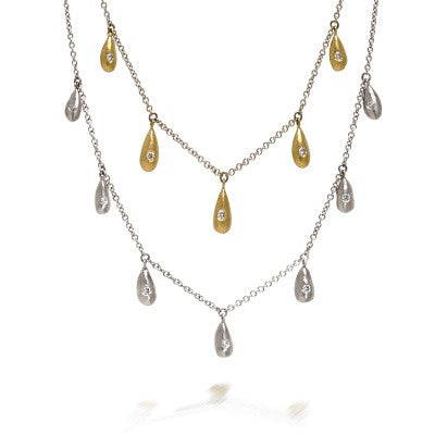 Gold ingot layering necklaces with diamonds by Diana Widman Design in Chicago.