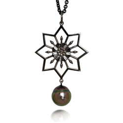 Silver Lotus pendant with black, Tahitian pearl drop by Diana Widman Design in Chicago.