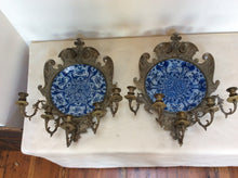 "Pair of bronze and delft wall sconces 28""h23""w,9""d"