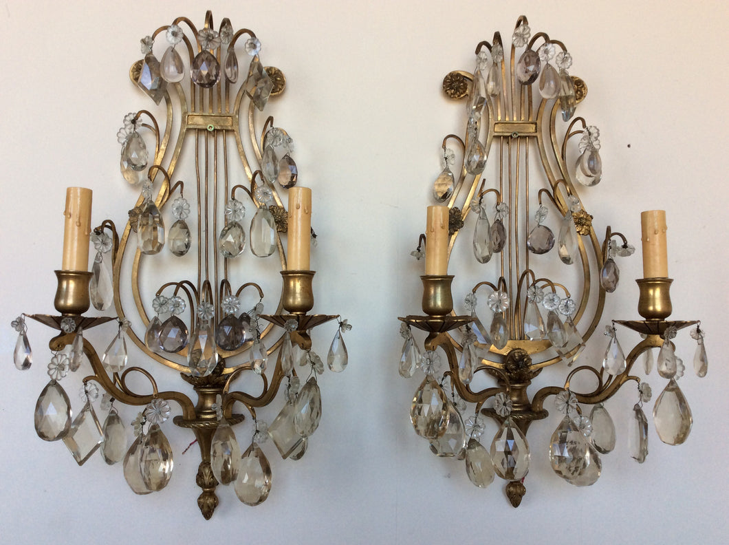Pair of Crystal sconces with lyre back design