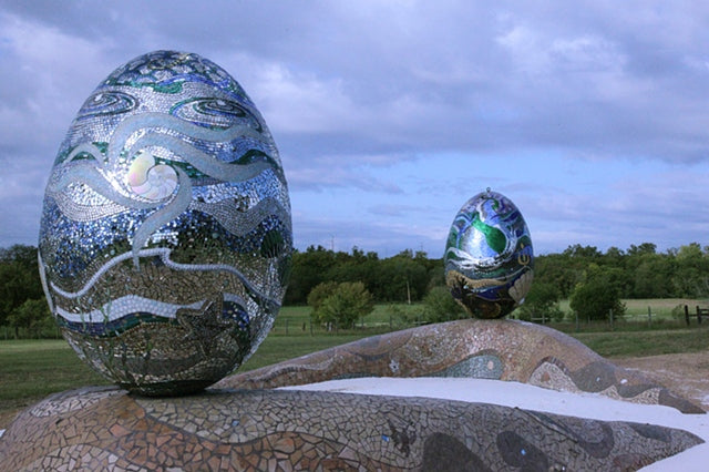 """Ocean(egg)raphy"" by Dianne Sonnenberg - 600 square foot sculptural mosaic installation.  Two 6' eggs on boomerang shaped bases grace a ranch setting outside Austin, Texas. Winner of the 2010 Mosaic Arts International Best Architectural Mosaic award."