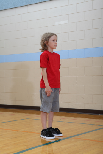 Boy performing squat thrust to build muscular strength
