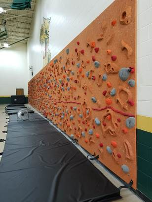 Sandstone Relief Feature Climbing Wall with black safety mats by Everlast Climbing