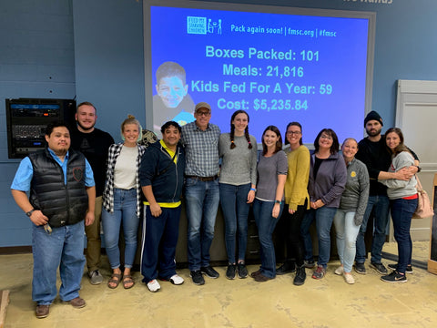 Everlast Climbing Staff volunteering at Feed My Starving Children