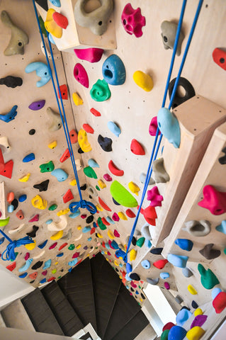 Home climbing wall with volumes and hand holds