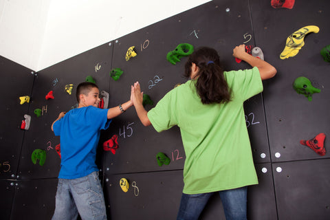Children being kind and caring on a Traverse Wall