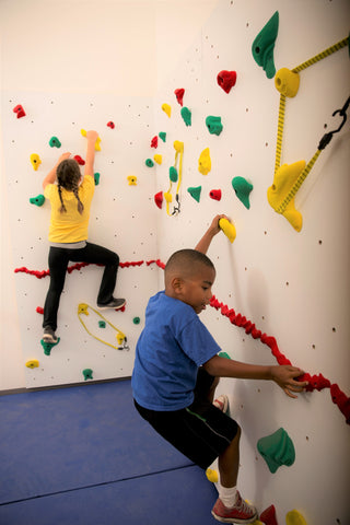 Boy and girl rock climbing