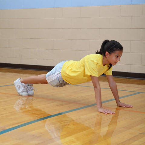 Girl performing a high plank to build muscle strength for rock climbing