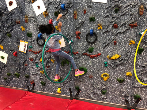 Students climbing on a Traverse Wall using ring holds