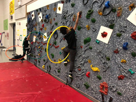 Students climbing on a Traverse Wall through Versa Challenge Course accessory