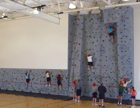 Students rock climbing on a Combi Wall by Everlast Climbing