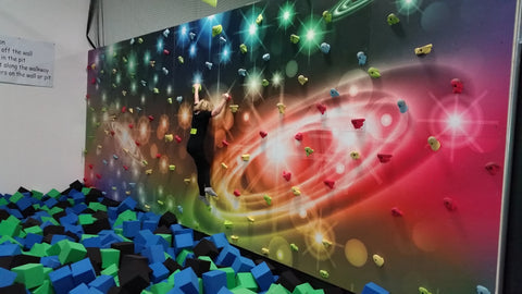 Mural climbing wall with a space theme by Everlast Climbing