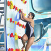 Kersplash Pool Climbing Wall with Colored Panels with Girl Climber