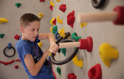 Use the Ultimate Traverse Wall Challenge Course with your climbing wall to add challenge.