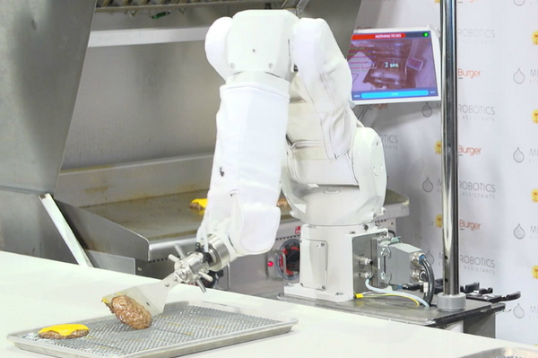 Robotic arm flipping burger
