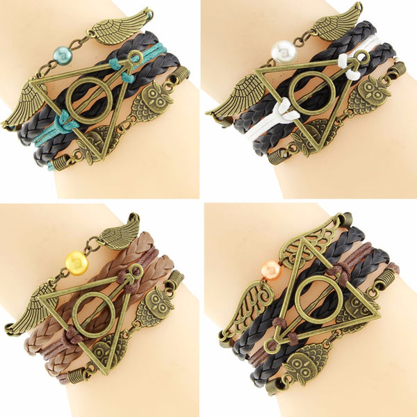 Harry Potter Bracelet Includes: Hedwig, Deathly Hollows, and Golden Snitch charms.