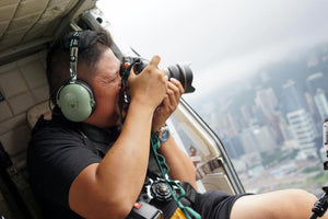 Laurence Lai Shooting on a Helicopter
