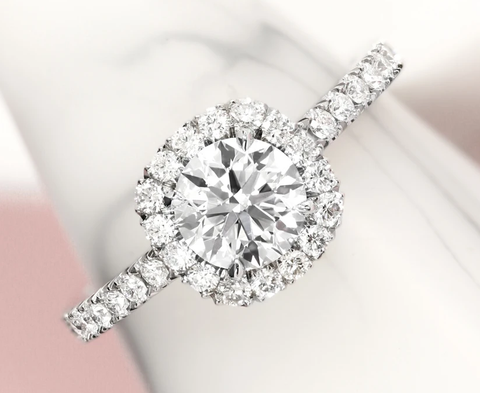 Astounding and Classy: Traditional Diamond with Halo of Smaller Stone