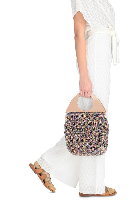 Missoni Circle Handle Bobble Bag in multicoloured bubble-stitched raffia available at Debs Boutique. Styled on model side view