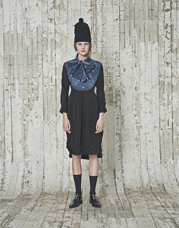 High by Claire Campbell Fervent Denim Dress in Navy with curved bib section in pre-creased denim available at Debs Boutique. Styled on model front view.