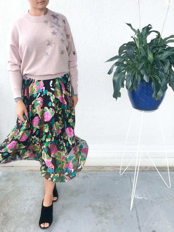 Saloni Ida Skirt in Hydrangea Floral print with soft sheer details, a high fitted waist and ankle length available at Debs Boutique. Styled on model wearing Zadig & Voltaire Gaby C Star Sweater and Clergerie Maevat Mules.